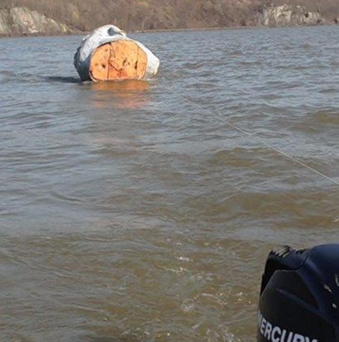 Is the head in front of our building the one found in the Hudson River?